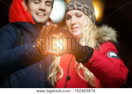 Beautiful spouses at Christmas on street at night