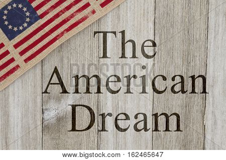 America patriotic message USA patriotic old flag on a weathered wood background with text The American Dream