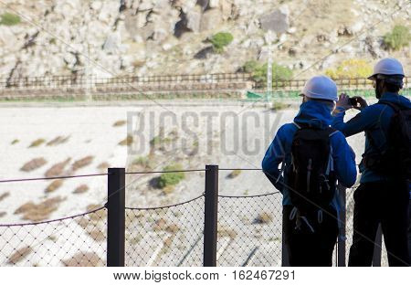 Traveling and trekking in nature couple concept. Couple walking by Caminito del Rey path Malaga Spain
