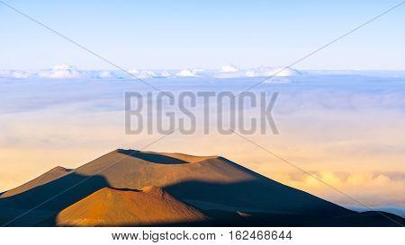 View of Volcano craters from Mauna Kea Mountain summit at sunset, Big Island, Hawaii, Usa