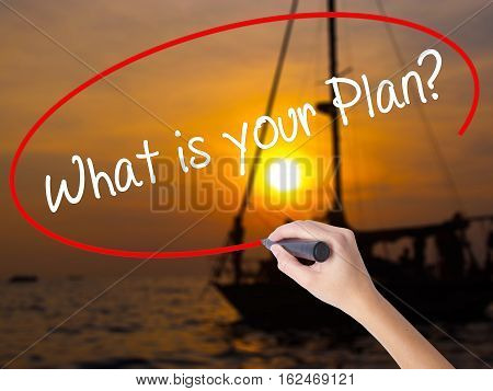 Woman Hand Writing What Is Your Plan? With A Marker Over Transparent Board