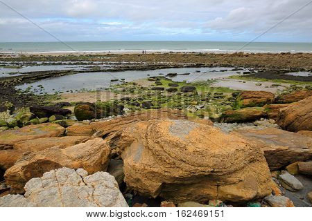 Cap Gris Nez in Cote d'Opale, Pas-de-Calais, France: View from the beach with colorful rocks