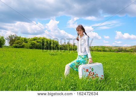 Happy Girl Goes Along The Green Field