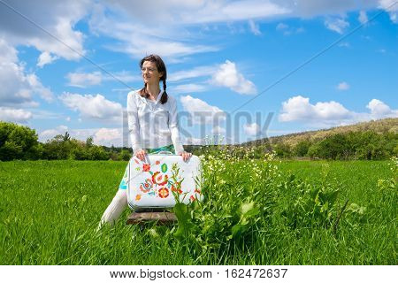 Dreaming Girl Standing In Green Field On Clouds  Background