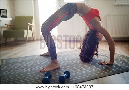Flexible Fit Woman Stretching At Home