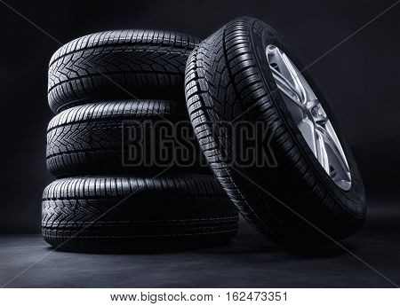 winter wheels in front of a black background