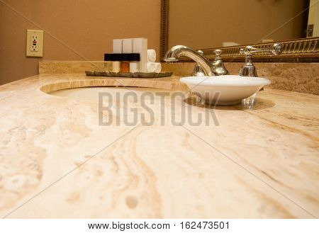 Close-up of bathroom sink, counter and faucet
