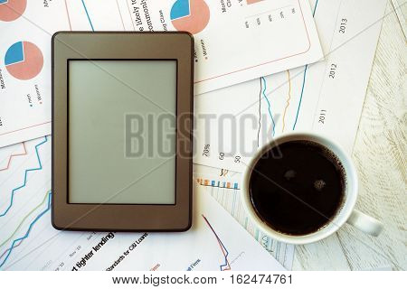 Workplace in office coffee and ebook top view