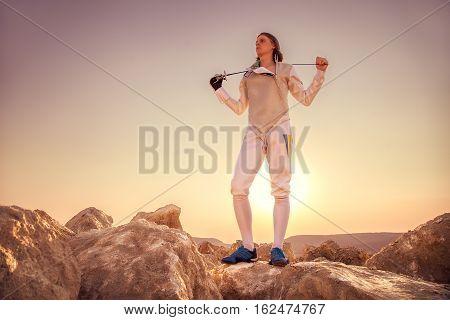 Fencer Man Holding Sword On The Shoulders