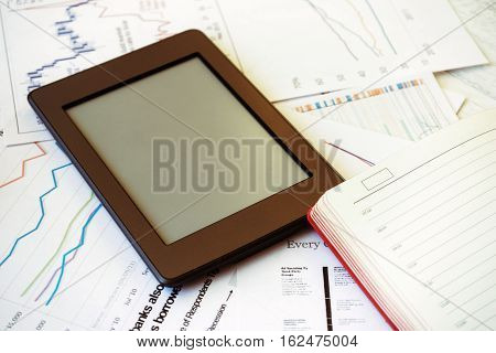 Workplace in office epad ebook and graphs