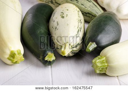 Variety of freshly picked vegetable - summer squash courgette zucchini patisson.