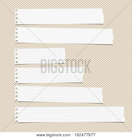 White ruled horizontal torn note, notebook, copybook paper sheets stuck on brown squared pattern.
