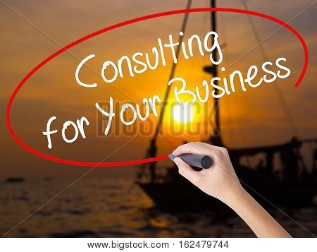 Woman Hand Writing Consulting For Your Business With A Marker Over Transparent Board