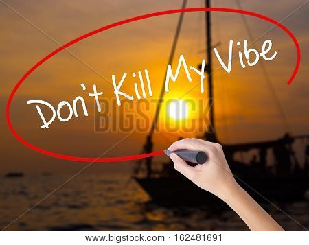 Woman Hand Writing Don't Kill My Vibe With A Marker Over Transparent Board