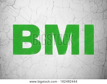 Health concept: Green BMI on textured concrete wall background