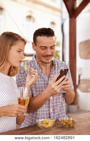 Dating Couple With Cellphone And Beers
