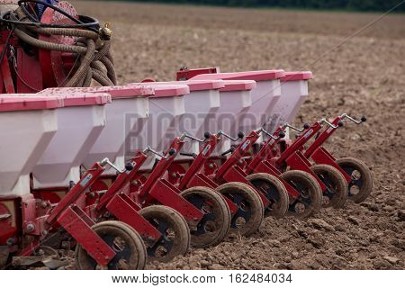 the agricultural machinery is working in field