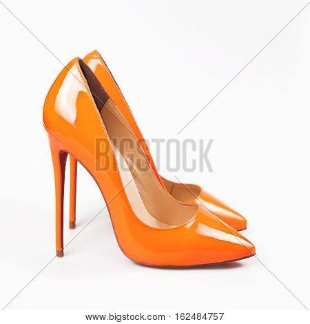 stylish Female orange shoes over white background