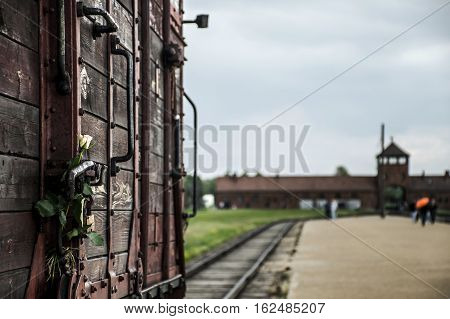 flower attached to Historic Train on rails at concentration camp Auschwitz Birkenau KZ Poland