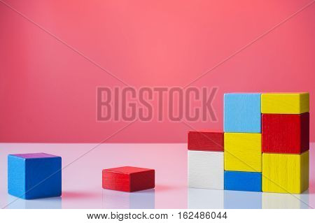 Abstract construction from wooden blocks with copy space. The concept of logical thinking geometric shapes.