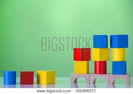 Abstract construction from wooden blocks with copy space. The concept of logical thinking geometric shapes. Logical task.