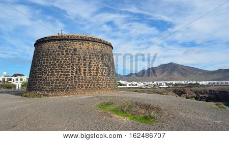 Seafront Panorama of Playa Blanca Lanzarote with Old Napolionic Fort.