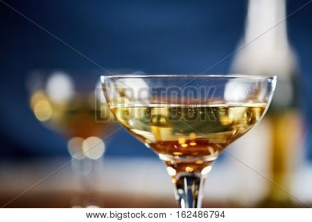 Closeup Glass Of Sparkling Wine And Bottle
