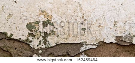 Plaster, old plaster on a brick wall. Old wall, old painting wall. Grunge, grunge background or texture. Stucco, stucco background, old stucco.