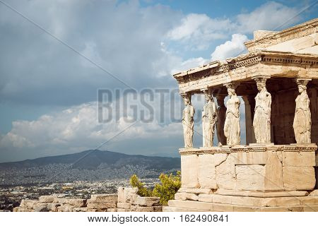 Acropolis Erectheion caryatids with panoramic view of the Athens Greece poster