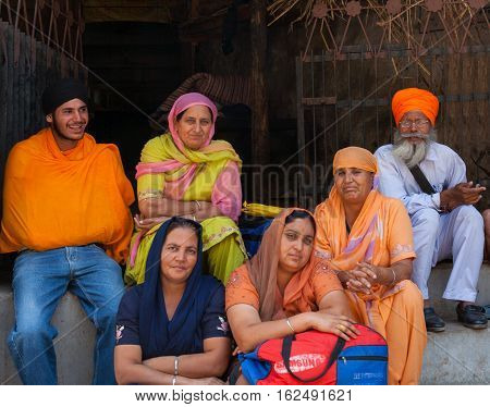 MANIKARAN, INDIA. 4 June 2009: Rural residents in daily life.  The family of Sikh pilgrims on vacation at the Sikh Gurdwara. Manikaran is a sacred pilgrimage centre for Sikhs, district Kullu in Himachal Pradesh, India.