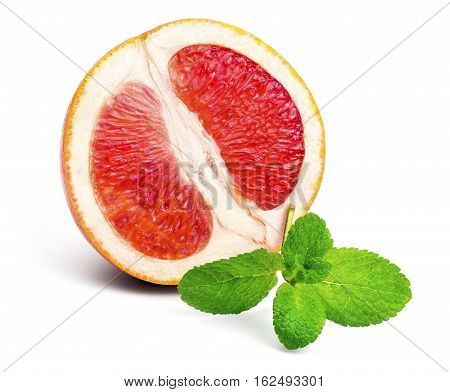 Half of ripe red grapefruit and a sprig of fresh mint isolated on white background.