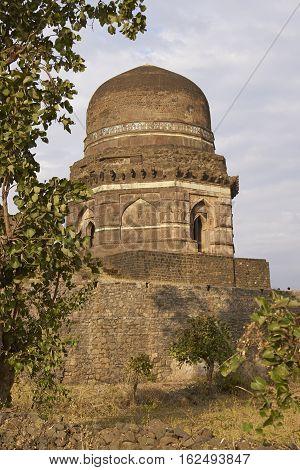 MANDU, INDIA - NOVEMBER 17, 2008: Historic building Dai ki Chhoti Bahan ka Mahal  inside the hilltop fort of Mandu in Madyha Pradesh, India. Islamic style architecture, constructed from 15th century onwards.