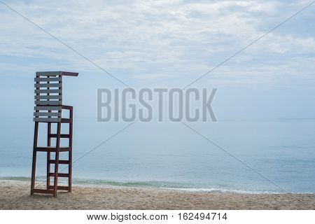 life guard chair on the beach with blue sky background