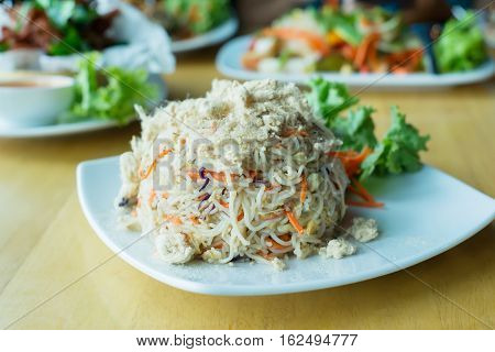 Asian fried rice vermicelli with dried shredded pork topping.