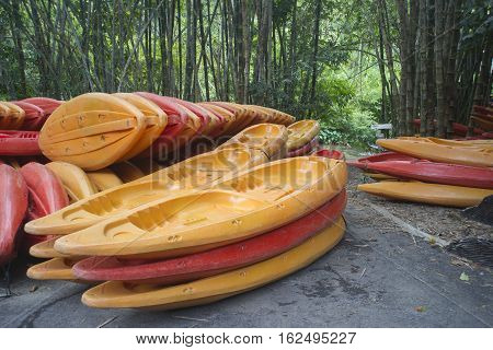 Colorful Kayaks boat upside down inside the river.
