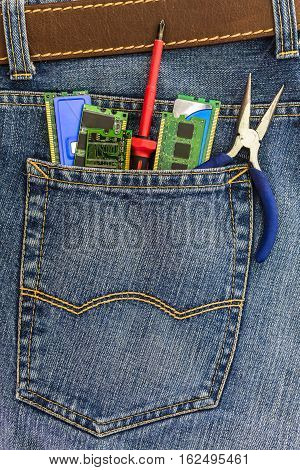 set of PC service tools in a back pocket of a blue denim jeans