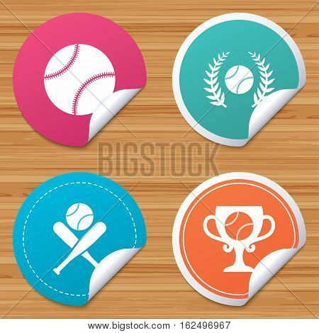 Round stickers or website banners. Baseball sport icons. Ball with glove and two crosswise bats signs. Winner award cup symbol. Circle badges with bended corner. Vector