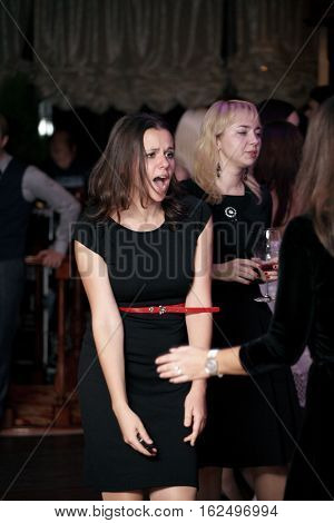 Kyiv, Ukraine - December 29, 2014: People dancing and clubbing on the party in Night club in Kyiv on December 29, 2014.Party in full swing, people having fun, crowded dancefloor in night club, disco entertainment