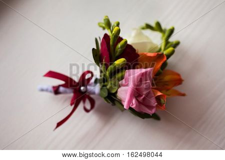 pink boutonniere groom collection preparation for the wedding wedding flowers