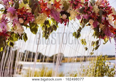 Wedding arch of white red yellow purple blue flowers wedding ceremony marriage registration wedding decorations the arch of roses wedding flowers