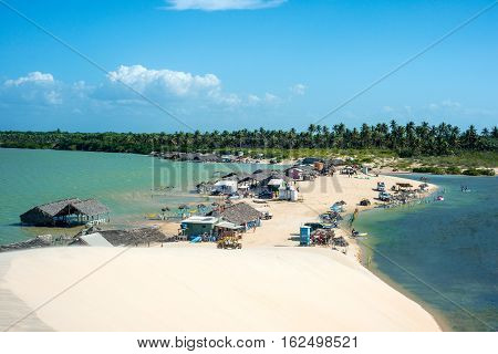 Jericoacoara Ceara state Brazil - July 2016: Lagoon Tatajuba from above; trucks buggy and other 4x4 transport with tourists traveling through the desert