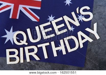 Queen's Birthday signage on the Australian flag.