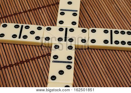 White dominoes pieces arranged for game play