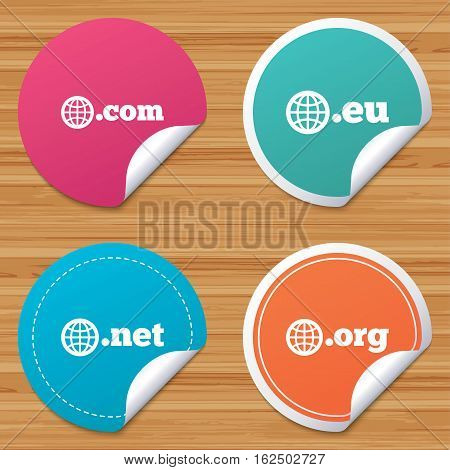 Round stickers or website banners. Top-level internet domain icons. Com, Eu, Net and Org symbols with globe. Unique DNS names. Circle badges with bended corner. Vector