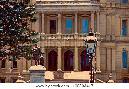 A photograph of the entrance to the State of Michigan Capitol Building during the Christmas season