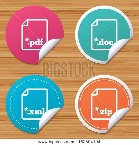 Round stickers or website banners. Download document icons. File extensions symbols. PDF, ZIP zipped, XML and DOC signs. Circle badges with bended corner. Vector