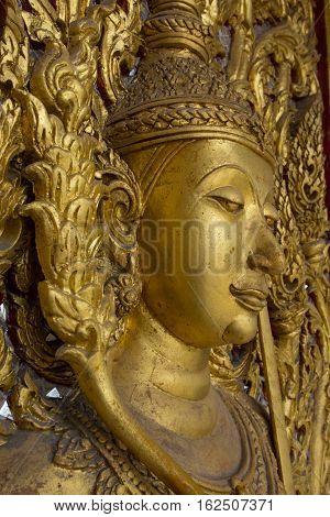 Buddha on the door Wat Thammamun Worawihan Temple, Chai Nat Province, Thailand.