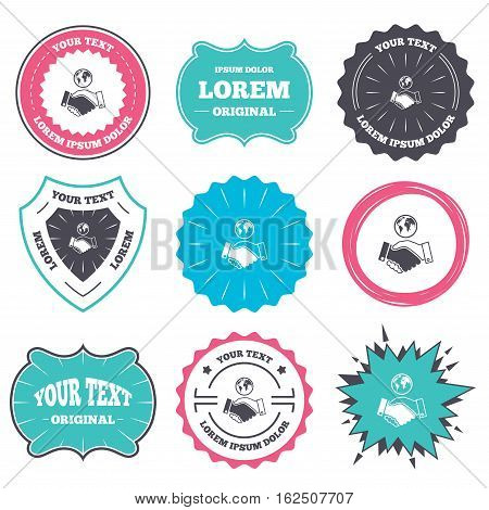 Label and badge templates. World handshake sign icon. Amicable agreement. Successful business with globe symbol. Retro style banners, emblems. Vector