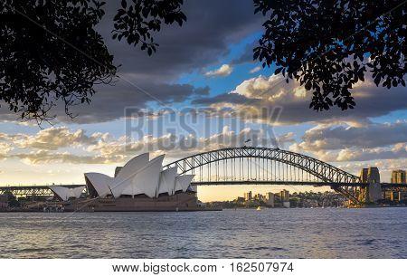 SYDNEY AUSTRALIA - December 17 2016: View Sydney CBD and The Opera House on sunset Sydney Australia Over 10 millions tourists visit Sydney every year