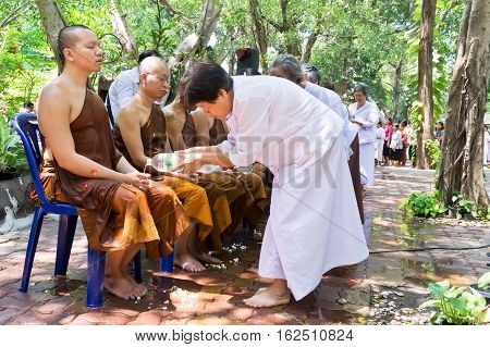 NONTHABURI THAILAND-APRIL13:people celebrate Songkran (new year / water festival: 13 April) by pouring water for buddhist priest and asking for blessings on April 13 2016 in NonthaburiThailand.